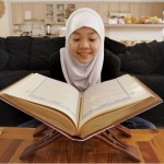 Muslim woman with Qur'an
