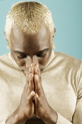 Young man in prayerful attitude